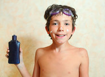 Handsome smiling preteen boy with anti sunburn cream Stock Photo