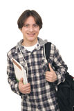 Handsome smiling teenager with bag pack and books. On white background royalty free stock photography