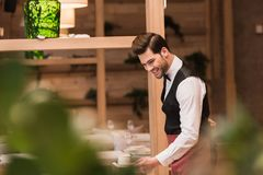 Waiter serving cup of coffee stock images