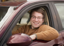 Man in car. Handsome smiling young man in car Stock Images