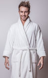Handsome Smiling Young Man In Luxurious Bathrobe. Stock Photography