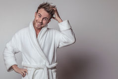 Handsome Smiling Young Man In Luxurious Bathrobe. Royalty Free Stock Photography