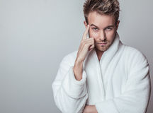 Handsome Smiling Young Man In Luxurious Bathrobe. Royalty Free Stock Images