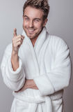 Handsome Smiling Young Man In Luxurious Bathrobe. Stock Photos