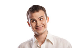 Handsome smiling young man looking up isolated Royalty Free Stock Images