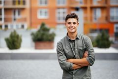 Handsome smiling young man portrait. Cheerful man looking at camera Stock Photos