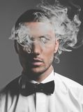 Handsome smoker. Fashion art portrait of a handsome man smoking Royalty Free Stock Image