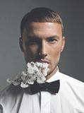 Handsome smoker. Fashion art portrait of a handsome man smoking Stock Photography