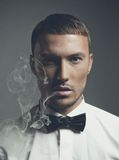 Handsome smoker Stock Photo