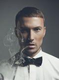 Handsome smoker. Fashion art portrait of a handsome man smoking Stock Photo