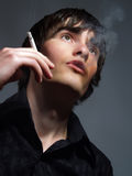 Handsome smoker Royalty Free Stock Photography