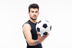 Handsome soccer player holding ball Royalty Free Stock Images