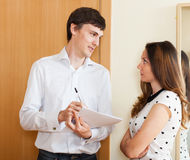 Handsome social worker questioning woman Royalty Free Stock Photo