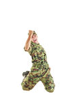 Handsome soldier in green camouflage uniform and hat jumping stock photo