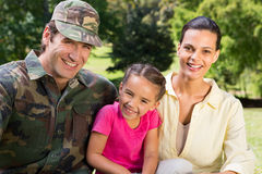 Handsome soldier reunited with family. On a sunny day royalty free stock photos
