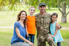 Handsome soldier reunited with family. On a sunny day stock images