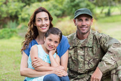 Handsome soldier reunited with family. On a sunny day royalty free stock photography