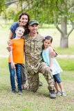 Handsome soldier reunited with family. On a sunny day stock photo