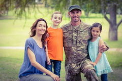 Handsome soldier reunited with family Royalty Free Stock Image