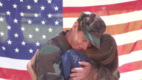 Handsome soldier reunited with partner. Against an american flag stock footage