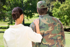 Handsome soldier reunited with partner Stock Photos
