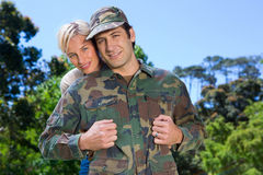 Handsome soldier reunited with partner Stock Image