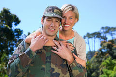 Handsome soldier reunited with partner Royalty Free Stock Image