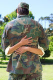 Handsome soldier reunited with partner Royalty Free Stock Photography