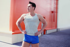 Handsome sports man posing in the city, workout, fitness, sport royalty free stock images