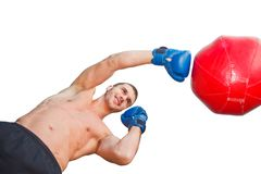 Handsome sports smilling man boxer. Trains hand punches with a punching bag. Bottom view stock images