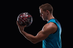 Handsome sportsman in blue uniform Royalty Free Stock Photos