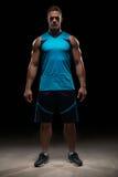 Handsome sportsman in blue uniform Royalty Free Stock Images