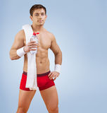 A handsome sportsman with bottle of water Royalty Free Stock Photos