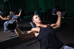 Handsome sportsman doing bench press exercise Royalty Free Stock Image