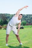 Handsome sportsman doing exercises outdoors Royalty Free Stock Image