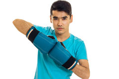 Handsome sportsman practicing boxing in blue gloves isolated on white background Royalty Free Stock Photography