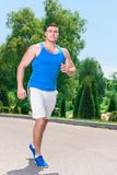 Handsome sportsman during running Royalty Free Stock Images