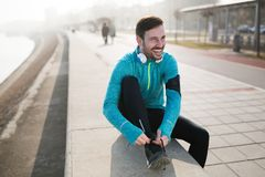 Handsome sportsman training jogging and exercising outdoor. Active handsome sportsman training jogging and exercising outdoor Stock Images