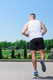 Handsome sportsman training outdoors Royalty Free Stock Photos