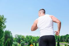 Handsome sportsman training outdoors Stock Photo