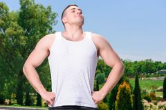 Handsome sportsman training outdoors Stock Photography
