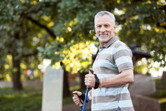 Handsome sporty grandfather outside his house Stock Photos