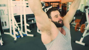 Handsome sporty man is exercising in fitness club and gym center stock video footage
