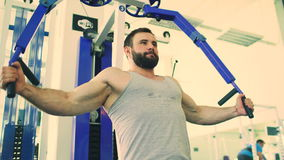 Handsome sporty man is exercising in fitness club and gym center stock footage