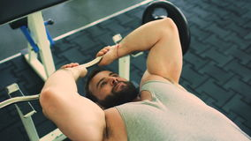 Handsome sporty man is exercising in fitness club and gym center stock video