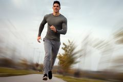Jogging handsome sporty man Royalty Free Stock Photography