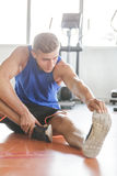 Handsome sporty man stretching his feet Royalty Free Stock Photos