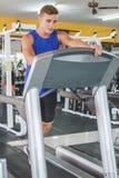 Handsome sporty man on treadmill Royalty Free Stock Photos