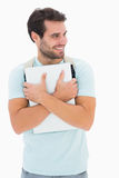 Handsome student carrying notepad and backpack Royalty Free Stock Photos