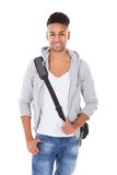 Handsome student carrying shoulder bag Royalty Free Stock Photos